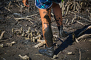 Karina Jacany's legs covered in fishpond mud.