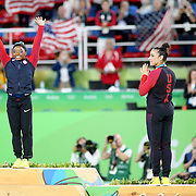 Gymnastics - Olympics: Day 6 Simone Biles of the United States on the podium at the gold medal presentation watched by silver medal medalist Alexandra Raisman of the United States during the Artistic Gymnastics Women's Individual All-Around Final at the Rio Olympic Arena on August 11, 2016 in Rio de Janeiro, Brazil. (Photo by Tim Clayton/Corbis via Getty Images)