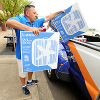 Steve Tybor, Executive Director with Eight Days of Hope, loads box fans in their truck that had been donated earlier in the day on Monday at the BancorpSouth Arena. Eight Days of Hope will be taking donations until Wednesday of power equipment and power related items to assist in the recovery process in Houston Texas.