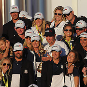 Ryder Cup 2016. Day Three. The United States team players and their spouses and partners celebrate with the Ryder Cup after the United States victory in the Ryder Cup tournament at Hazeltine National Golf Club on October 02, 2016 in Chaska, Minnesota.  (Photo by Tim Clayton/Corbis via Getty Images)