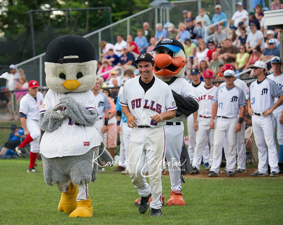 Shea Donlin of the Newport Gulls is welcomed on the field by Mascots Gully Jr and Gully prior to the start of the New England Collegiate All Star Game at Robbie Mill Field Sunday evening.  (Karen Bobotas/for the Laconia Daily Sun)