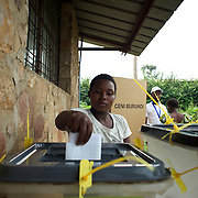 A voter casts her vote at a polling station in Kinama neighbourhood in Bujumbura, to vote in the country's parliamentary elections, on June 29, 2015.