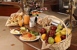 breakfast buffet with eggs, waffles, fruit and coffee
