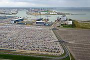 Nederland, Zeeland, Vlissingen, 23-10-2013; Sloehaven, Damen Shipyards en auto-overslag Cobelfret met de RoRo Terminal vol auto's die wachten op vervoer. Rechts de Westerschelde.<br /> Port of Vlissingen, the roro terminal of Cobelfret Car transshipment and cars waiting for transport,  view on Westerschelde.<br /> luchtfoto (toeslag op standaard tarieven);<br /> aerial photo (additional fee required);<br /> copyright foto/photo Siebe Swart.