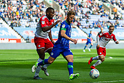 Wigan Michael Jacobs chases the ball during the EFL Sky Bet Championship match between Wigan Athletic and Barnsley at the DW Stadium, Wigan, England on 31 August 2019.
