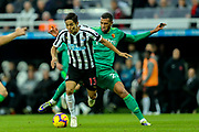 Yoshinori Muto (#13) of Newcastle United is fouled by Etienne Capoue (#29) of Watford during the Premier League match between Newcastle United and Watford at St. James's Park, Newcastle, England on 3 November 2018.