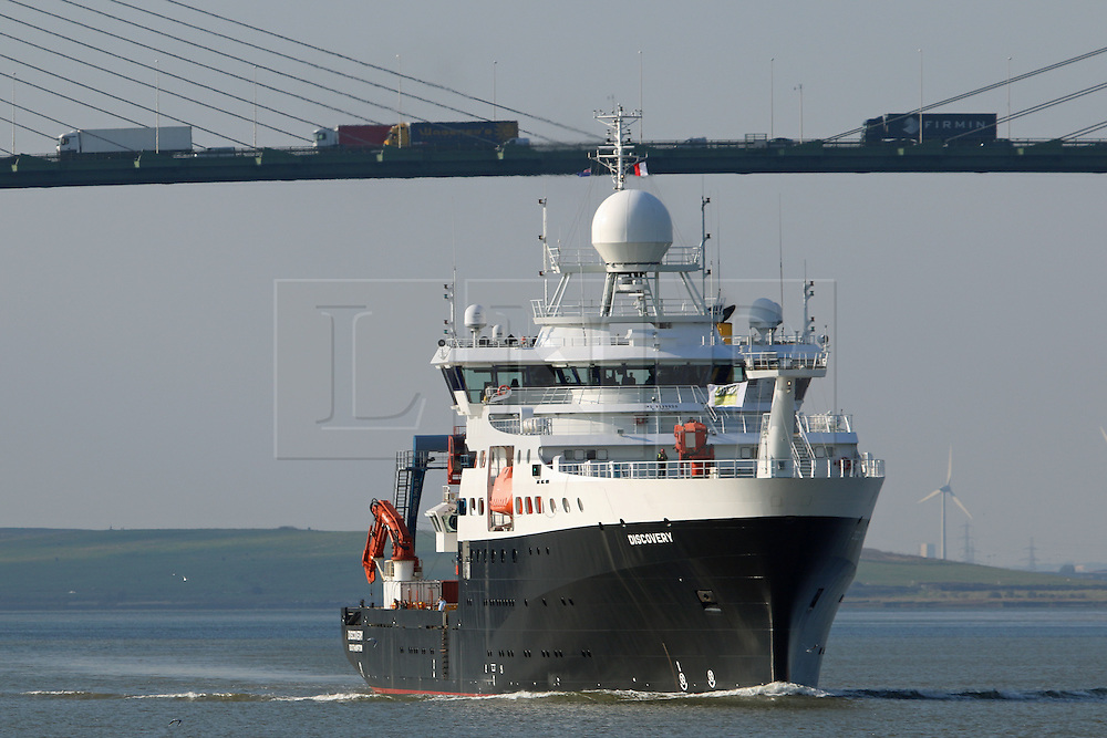 © Licensed to London News Pictures. 12/10/2015.  The scientific Royal Research Ship RRS DISCOVERY has left London after the vessel's maiden voyage to the capital. The ship was launched in 2013 and is operated by the Natural Environment Research Council. RRS Discovery was moored alongside HMS Belfast for the duration of her stay. Credit : Rob Powell/LNP