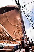 Lowering the sails on Alila Purnama.