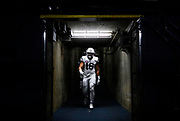 BYU linebacker Harvey Langi walks to the field before the team's Poinsettia Bowl NCAA college football game against Wyoming on Wednesday, Dec. 21, 2016, in San Diego. (AP Photo/Ryan Kang)