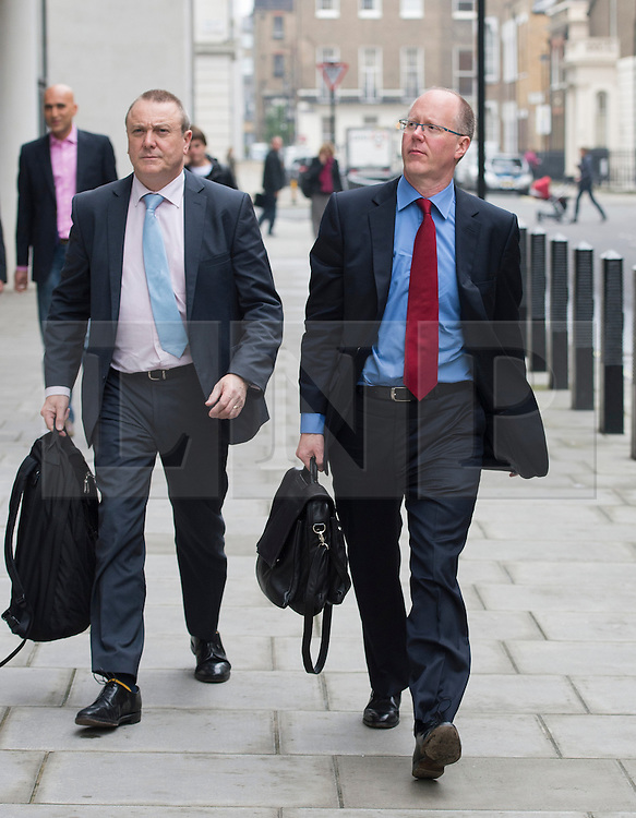 © London News Pictures. 23/10/2012. London, UK.  Director General of the BBC George Entwistle (right) arriving at BBC Broadcasting House in London AFTER giving evidence to the Commons Culture Committee on the BBC's response to the Jimmy Savile affair. The BBC has been accused of covering up an under age sex scandal involving presenter Jimmy Savile, who died in 2011. Photo credit: Ben Cawthra/LNP