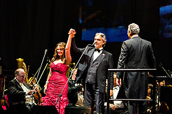 ANAHEIM, CA - JUN 9: Italian tenor Andre Bocelli performed Granada, New York, La Boheme, La Traviata among others keeping audience mesmerized at the Honda Center in Anaheim, CA. The magical night included producer David Foster on Piano, Violinist Caroline Campbell, American Idol Season 3 winner Soul Singer Fantasia, Cuban Soprano Maria Aleida and Orchestra Conductor Eugene Kohn. Italian tenor Andre Bocelli (C) thanks Cuban soprano Maria Aleida whith conductor Eugene Kohn (R). All fees must be agreed prior to publication, Byline and/or web usage link must  read  PHOTO: SilvexPhoto.com