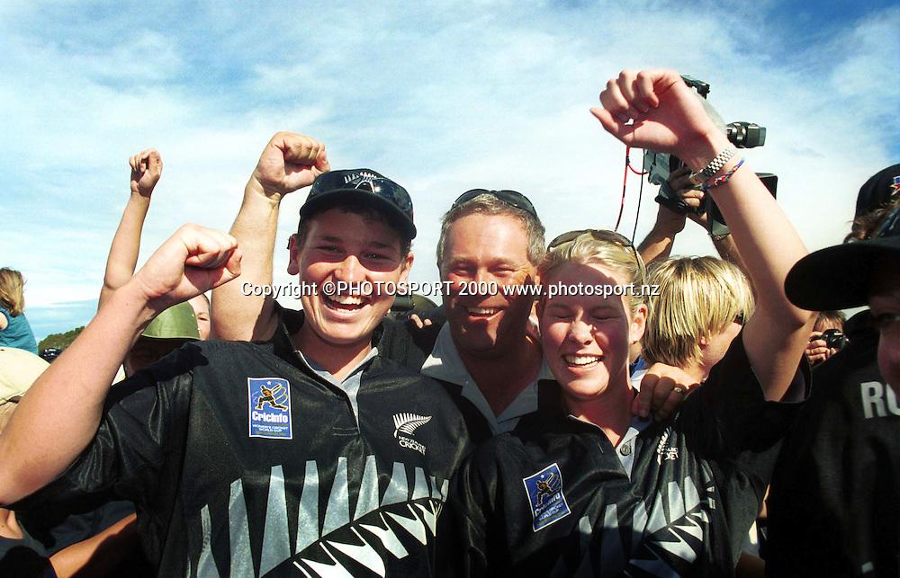 Rachel Pullar, John Reid and Emily Travers celebrate winning the Womens Cricket World Cup 2000 played at Bert Sutcliffe Oval, Lincoln, New Zealand 23 December 2000. NZ women won by 4 runs. Photo: Sandra Teddy/Photosport.co.nz