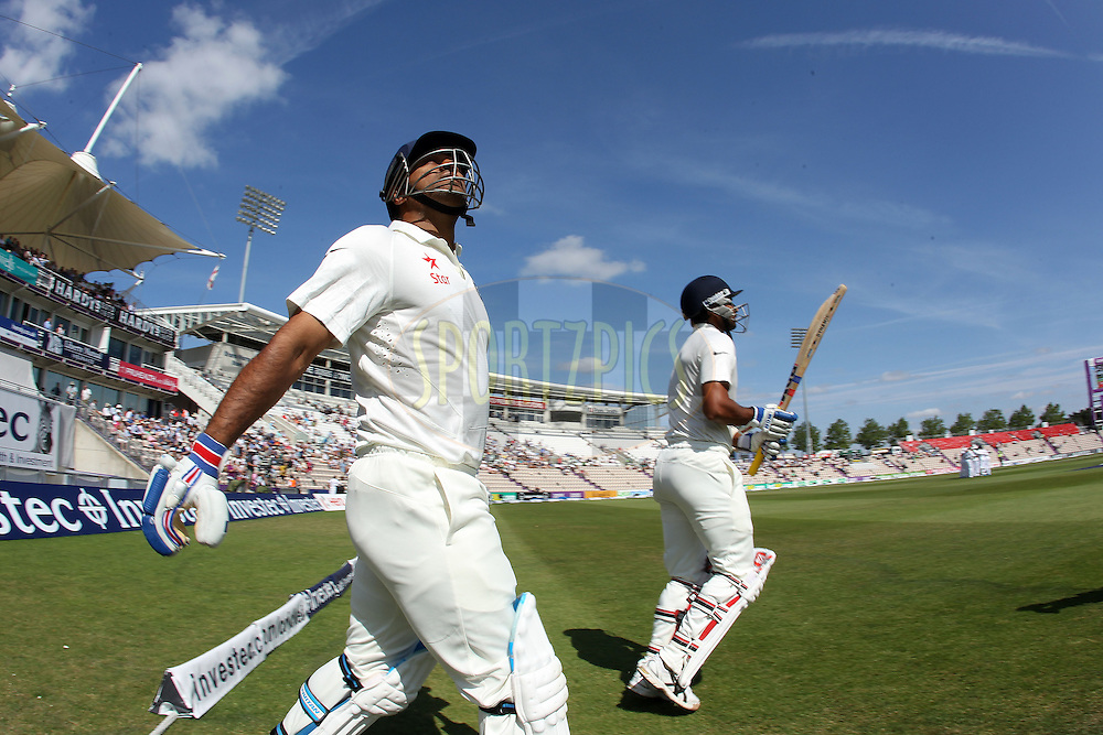 Mahendra Singh Dhoni captain of India and Mohammed Shami of India take to the field on during day four of the third Investec Test Match between England and India held at The Ageas Bowl cricket ground in Southampton, England on the 30th July 2014<br /> <br /> Photo by Ron Gaunt / SPORTZPICS/ BCCI