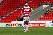 Doncaster Rovers Defender Niall Mason (24) prepares to take a free kick during the EFL Sky Bet League 2 match between Doncaster Rovers and Blackpool at the Keepmoat Stadium, Doncaster, England on 17 April 2017. Photo by Craig Zadoroznyj.