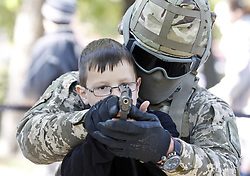 October 6, 2018 - Kiev, Ukraine - An Ukrainian border guard soldier teaches a boy to hold a gun, during a children festival 'City of professions' in Kiev. The festival aims to enable children to try themselves in different professions like rescuer, firefighter, explorer, policeman, doctor, social worker. (Credit Image: © Str/NurPhoto/ZUMA Press)