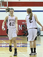Monticello's Allison Kraus (42) congratulates Brooke Stahlberg (2) after her score during their Rivalry Saturday game at Washington High School at 2205 Forest Drive SE in Cedar Rapids on Saturday, January 21, 2012. (Stephen Mally/Freelance)