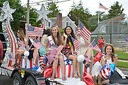 Wantagh, New York, USA. July 4, 2015. Past participants in The Miss Wantagh Pageant ceremony, a long-time Independence Day tradition on Long Island, ride on a float in the town's July 4th Parade. After the parade, the Miss Wantagh Pageant 2015 ceremony was held. Since 1956, the Miss Wantagh Pageant, which is not a beauty pageant, crowns a high school student based mainly on academic excellence and community service.