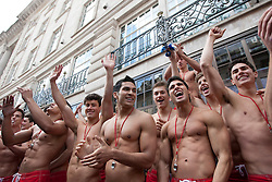 © licensed to London News Pictures. London, UK 12/05/2012. 100 Lifeguards posing as they promote opening of the new Gilly Hicks and Hollister Flagship Stores on Regent Street, this morning (12/05/12). Photo credit: Tolga Akmen/LNP