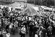 Parachute laying over Police van and crowd. Reclaim the Streets, Shepherd's Bush, London, July 1996
