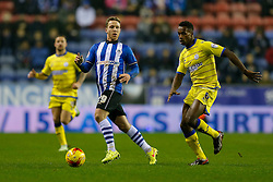 Adam Forshaw of Wigan is challenged by Jose Semedo of Sheffield Wednesday - Photo mandatory by-line: Rogan Thomson/JMP - 07966 386802 - 30/12/2014 - SPORT - FOOTBALL - Wigan, England - DW Stadium - Wigan Athletic v Sheffield Wednesday - Sky Bet Championship.