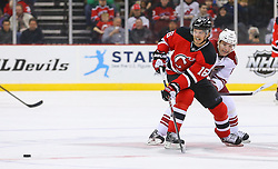 Mar 27, 2014; Newark, NJ, USA; New Jersey Devils center Jacob Josefson (16) passes the puck while being defended by Phoenix Coyotes right wing Radim Vrbata (17) during the first period at Prudential Center.