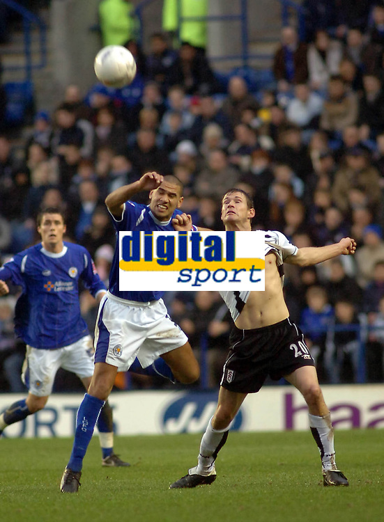 Photo: Kevin Poolman.<br />Leicester City v Fulham. The FA Cup. 06/01/2007. Patrick Kisnorbo of Leicester and Fulham's Brian McBride fight over a header.
