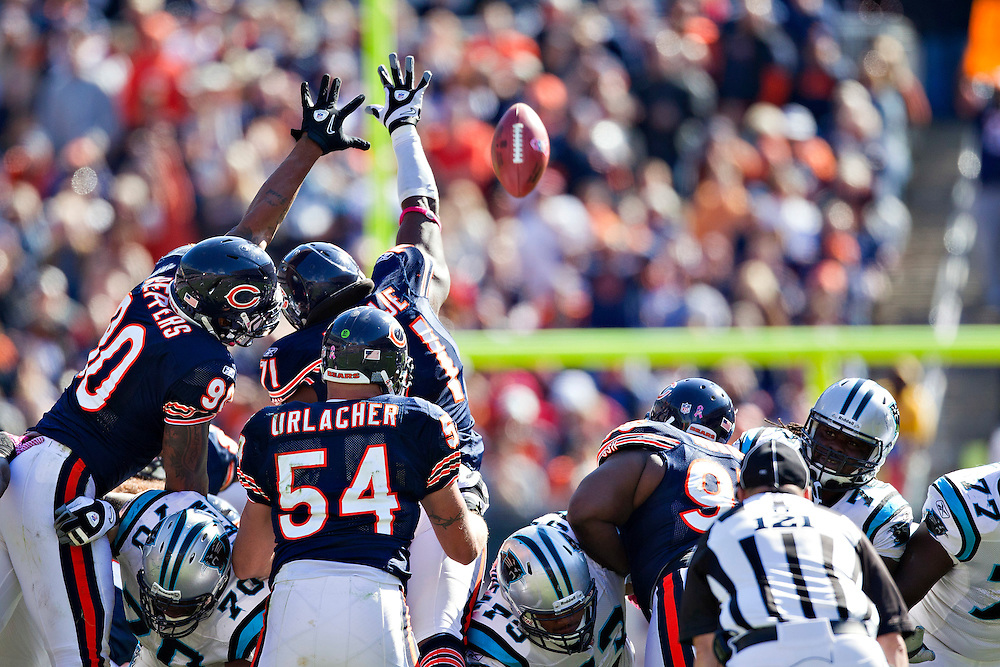 CHICAGO, IL - OCTOBER 2:  Julius Peppers #90 and Israel Idonije #71 of the Chicago Bears try to block a field goal attempt during a game against the Carolina Panthers at Soldier Field on October 2, 2011 in Chicago, Illinois.  The Bears beat the Panthers 34 to 29.  (Photo by Wesley Hitt/Getty Images) *** Local Caption *** Julius Peppers; Israel Idonije