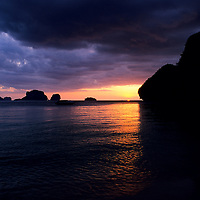 Karst islands silhouetted under storm clouds at sunset, Rae Leh Beach, Thailand