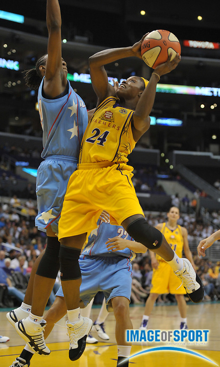 May 30, 2010; Los Angeles, CA, USA; Los Angeles Sparks guard Marie Ferdinand-Harris (24) is defended by Atlanta Dream forward Sancho Lyttle (20) in the first half at the Staples Center. The Dream defeated the Sparks 101-82.