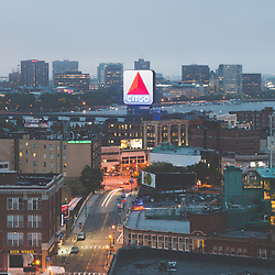 Boston skyline aerial photo with the Citgo sign, East Cambridge skyline, Fenway Park, Kenmore Square, Harvard Bridge, and the Charles River. Boston Massachusetts is a major city in the Eastern United States of America. Copyright ⓒ Paul Velgos with All Rights Reserved.