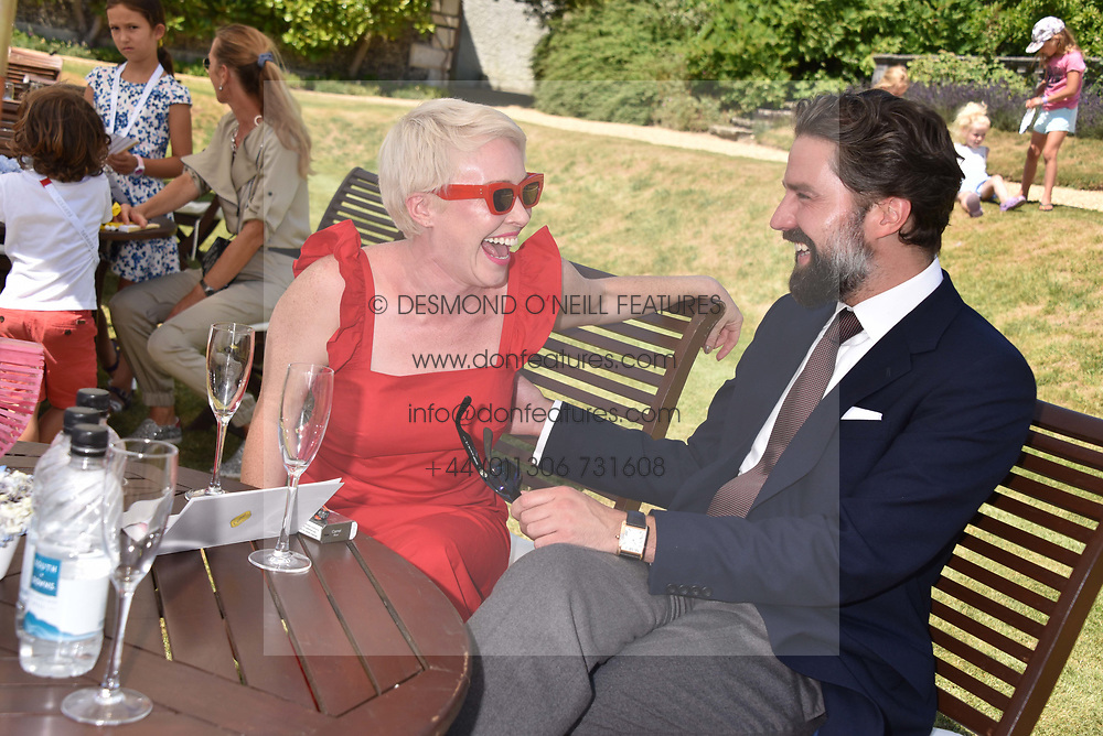 Daisy Lewis and Jack Guinness at the 'Cartier Style et Luxe' enclosure during the Goodwood Festival of Speed, Goodwood House, West Sussex, England. 15 July 2018.