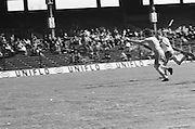 Cork chases along side Wexford who is in possession of the ball during the All Ireland Senior Camogie Final Cork v Wexford in Croke Park on the 21st September 1975. Wexford 4-3 Cork 1-2.