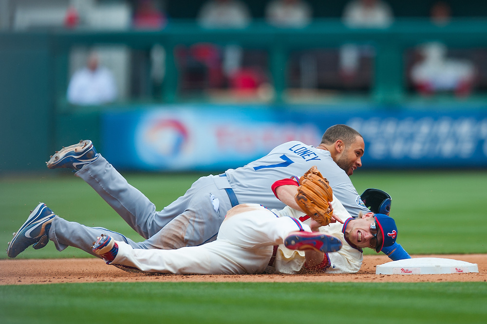 PHILADELPHIA, PA - JUNE 07: James Loney #7 of the Los Angeles Dodgers slides into second and collides with Mike Fontenot #18 of the Philadelphia Phillies as he defends his position during the game between the two teams at Citizens Bank Park on June 7, 2012 in Philadelphia, Pennsylvania. (Photo by Rob Tringali) *** Local Caption *** James Loney;Mike Fontenot