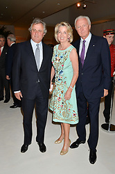 Left to right, VISCOUNT ASTOR and GALEN & HILARY WESTON at a dinner hosted by Cartier in celebration of The Chelsea Flower Show held at The Hurlingham Club, London on 19th May 2014.