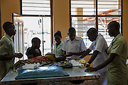 Nurses and attendants caring for a sick child on the children's ward of St Walburg's Hospital, Nyangao. Lindi Region, Tanzania.