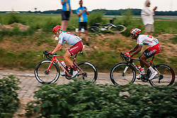 Leaders with Mads Wurtz (DEN) of Team Katusha - Alpecin (SUI,WT,Canyon) on the cobblestone sector at Thiméon during stage 1 from Bruxelles to Brussel of the 106th Tour de France, 6 July 2019. Photo by Pim Nijland / PelotonPhotos.com | All photos usage must carry mandatory copyright credit (Peloton Photos | Pim Nijland)