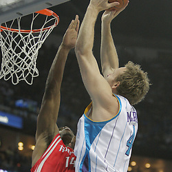 16 March 2009: New Orleans Hornets forward Sean Marks (4) attempts to dunk over Houston Rockets forward Carl Landry (14) during a NBA game between the New Orleans Hornets and the Houston Rockets at the New Orleans Arena in New Orleans, Louisiana.