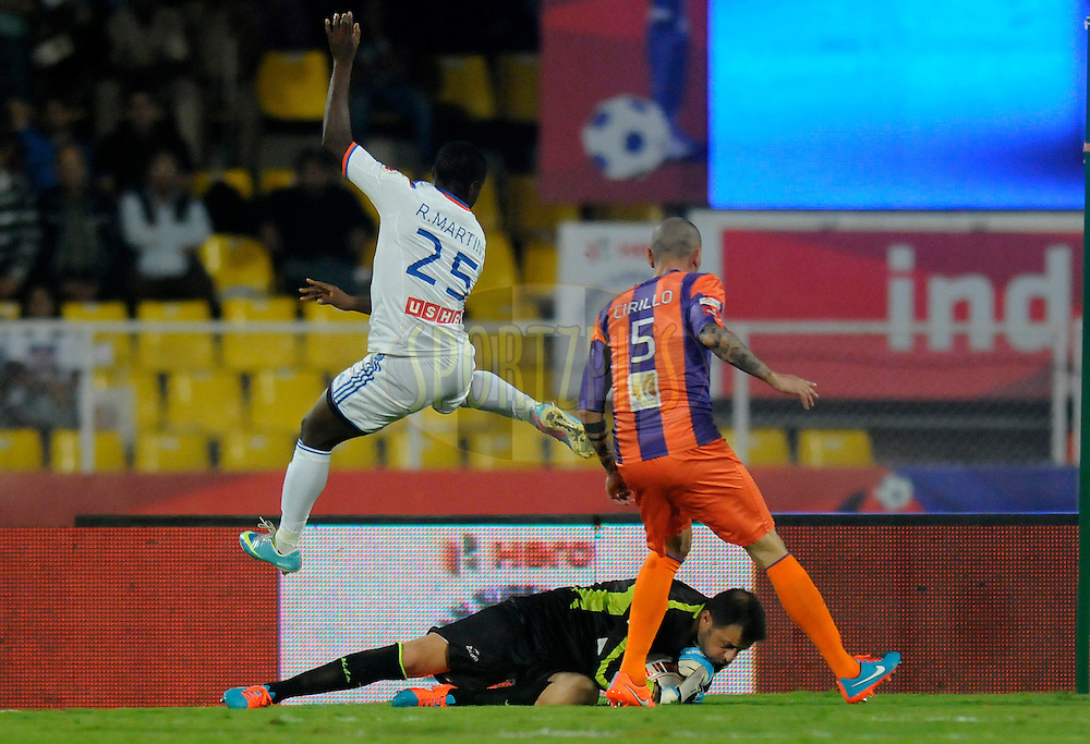 Emanuele Belardi of FC Pune City collects the ball during match 14 of the Hero Indian Super League between FC Pune City<br /> and FC Goa held at the Shree Shiv Chhatrapati Sports Complex Stadium, Pune, India on the 26th October 2014.<br /> <br /> Photo by:  Pal Pillai/ ISL/ SPORTZPICS