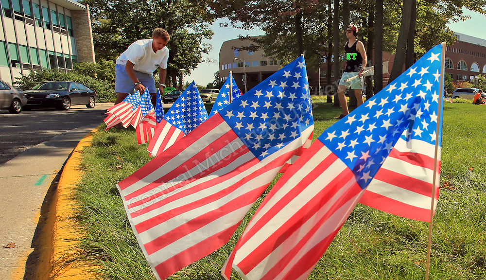 SEPTEMBER 10, 2013-- Greek fraternity members of Phi Kappa Tau decorate the area in front of the University Center on the CMU campus with 441 flags in honor of those firefighters and police officers that lost their lives on 9-11. Photo by Steve Jessmore