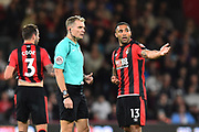 Callum Wilson (13) of AFC Bournemouth appeals for a penalty to referee Graham Scott after being challenged by Luke Shaw (23) of Manchester United during the Premier League match between Bournemouth and Manchester United at the Vitality Stadium, Bournemouth, England on 18 April 2018. Picture by Graham Hunt.