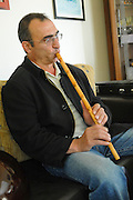 Israel, Carmel Mountain, Daliyat al-Karmel a Druze town in the North District, man plays a cane flute