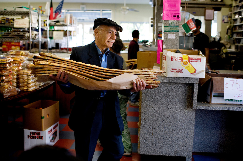 A man carries out his order of naan, at the Maiwand Market, in Fremont, Ca., on Saturday, March 7, 2009.