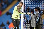 Manchester City goalkeeper Ederson (31) greets the ballboys before the Champions League match between Manchester City and Dinamo Zagreb at the Etihad Stadium, Manchester, England on 1 October 2019.