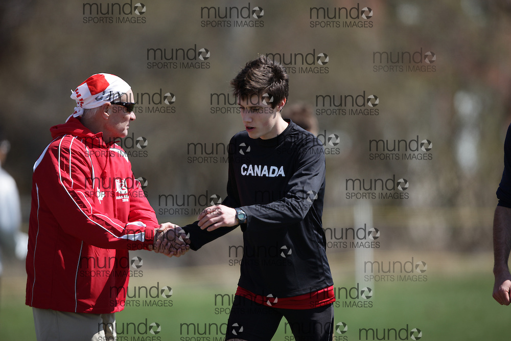 (Kingston, Canada---11 April 2010) Robert Kyle Boorsma (#113) of Canada (CAN) and Coach Bob Vigars\ runs in the \men's 10km race\ at the 17th World University Cross Country Championships (FISU) held on the Fort Henry Hill course in Kingston, Ontario, Canada. This photograph is Copyright Geoff Robins / Mundo Sport Images, 2010. For information, go to www.mundosportimages.com or contact info@mundosportimages.com.