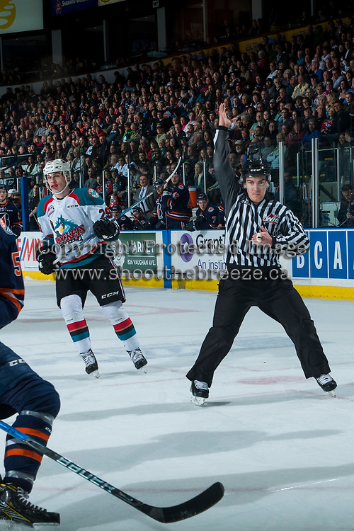 KELOWNA, CANADA - MARCH 31: Nolan Foote #29 of the Kelowna Rockets skates past linesman Kevin Crowell as he makes a call against the Kamloops Blazers on March 31, 2017 at Prospera Place in Kelowna, British Columbia, Canada.  (Photo by Marissa Baecker/Shoot the Breeze)  *** Local Caption ***