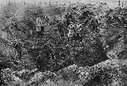 World War I 1914-1918: Western Front, 1917, Germans examining a crater left by the explosion of a mine.