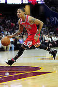 April 8, 2011; Cleveland, OH, USA; Chicago Bulls point guard Derrick Rose (1) drives the lane during the third quarter against the Cleveland Cavaliers at Quicken Loans Arena. The Bulls beat the Cavaliers 93-82. Mandatory Credit: Jason Miller-US PRESSWIRE