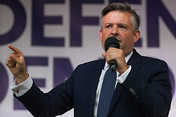London, UK. 4 September, 2019. Jon Ashworth, Shadow Secretary of State for Health, addresses Remain supporters at a Defend Our Democracy rally in Parliament Square shortly after MPs passed the Brexit delay bill in the House of Commons.