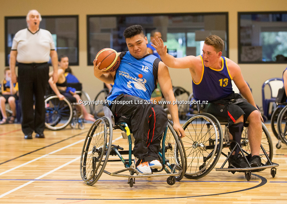 Auckland's Kaun Murray contests the ball with Otago's Luke McDonall, Wheelchair basketball, Day 1, Halberg Junior Disability Games, St Peter's School, Cambridge, New Zealand. Friday, 22 April, 2016. Copyright photo: John Cowpland / www.photosport.nz