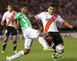 10.12.2014, River Plate Stadium, Buenos Aires, ARG, Südamerika Cup 2014, River Plate vs Atletico Nacional de Medellin, im Bild River Plate football player Gabriel Mercado (r) fights for the ball versus Daniel Boccanegra (l) from Atletico Nacional de Medellin // during the 2nd final match of Southamerican Cup between River Plate vs Atletico Nacional and Medellin at the River Plate Stadium in Buenos Aires, Argentina on 2014/12/10. EXPA Pictures © 2014, PhotoCredit: EXPA/ Eibner-Pressefoto/ Cezaro<br /> <br /> *****ATTENTION - OUT of GER*****